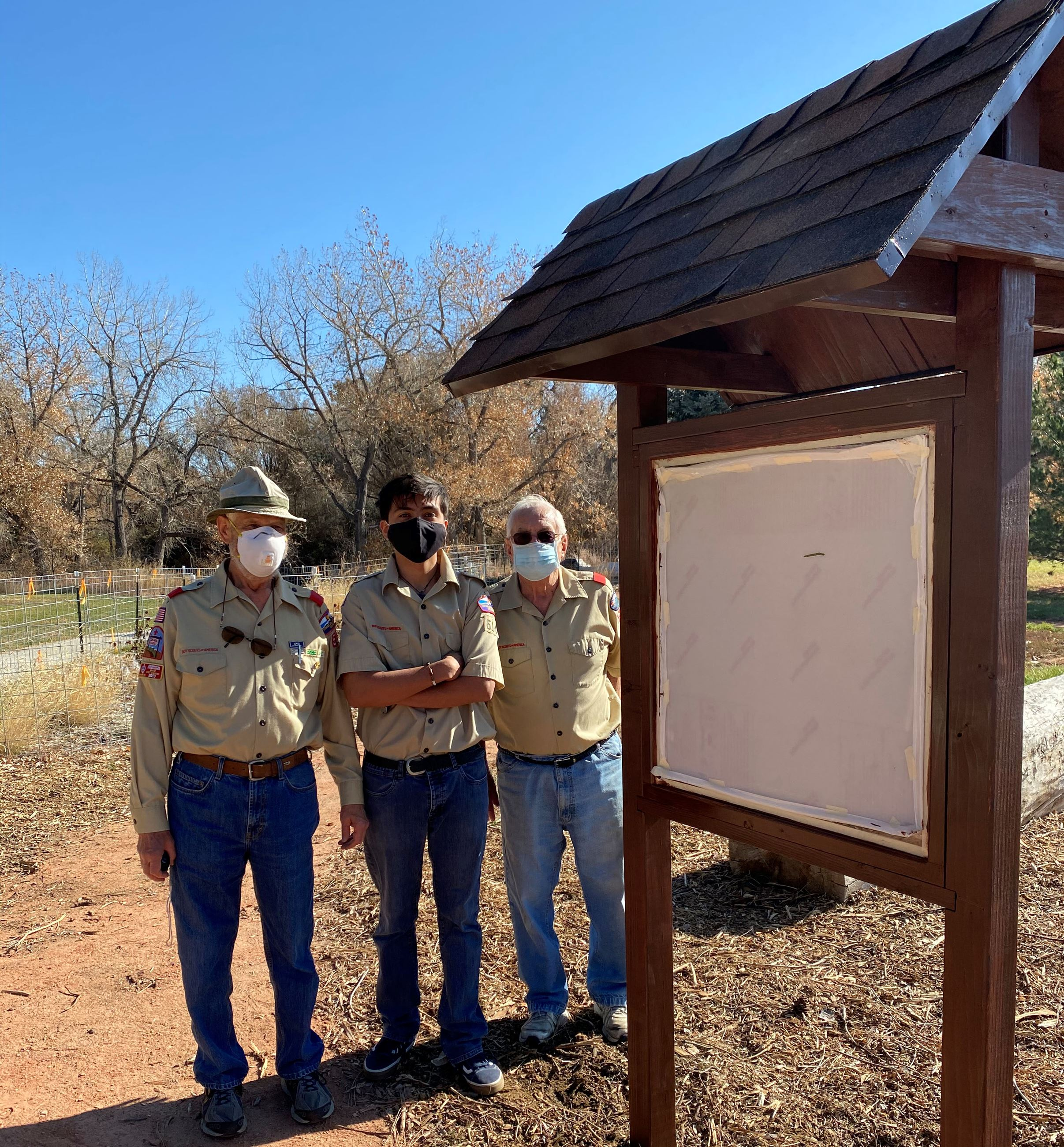 Scouts stand next to kiosk they built for Nature Play Area at Anderson Park