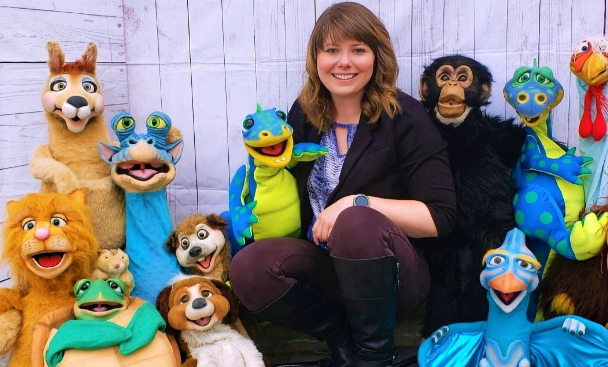 Ventriloquist, Meghan Casey surrounded by her puppets