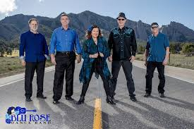 All five members of the Blu Rose Dance Band standing in road with mountains behind