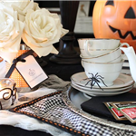 Table set with tea pot and cups and Halloween decor