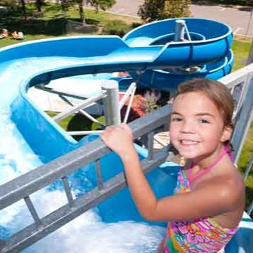 Girl preparing to go down a water slide
